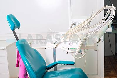 Stomatological instrument in the dentists clinic. Operation, tooth replacement.