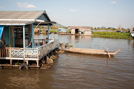 Children playing on the terrace of the house on the water of Lake Tonle Sap in Cambodia.