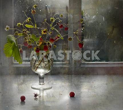 Processing in the style of painting. Against the window a glass of a glass of bouquet of flowers and strawberries.
