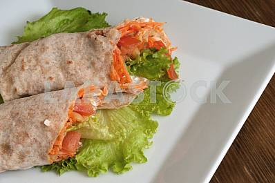 Vegetables with sour cream, wrapped in bread of pita