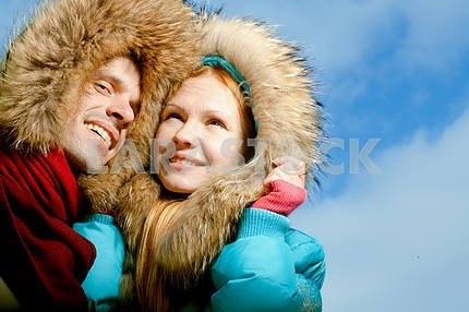 Young love Couple smiling against the winter sky