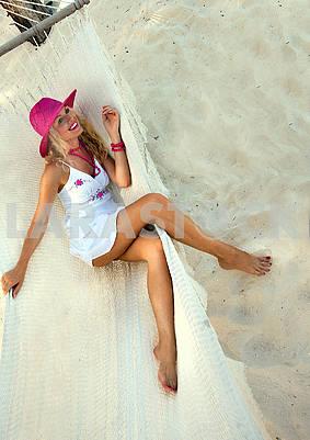 Cute girl resting in a hammock