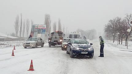 Cars on the snow-covered Nikolayev street
