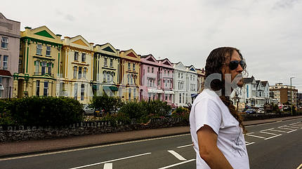 Man Standing in Front of a Row of Houses