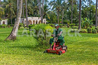 A man on a lawn mower