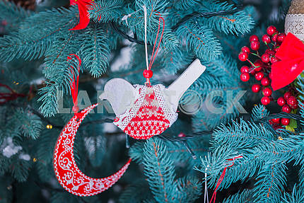 pine-tree decoration stylish, red  and white bird and moon, Christmas tree close-up