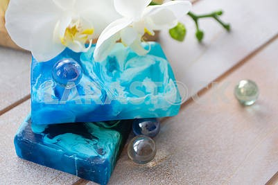 Handmade organic sea soap in teal and blue, orchid flower