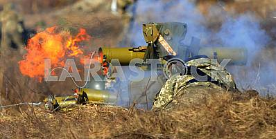 A soldier fired a grenade launcher