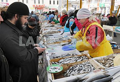 "A woman sells fish in the market ""Privoz"" April 6, 2012"