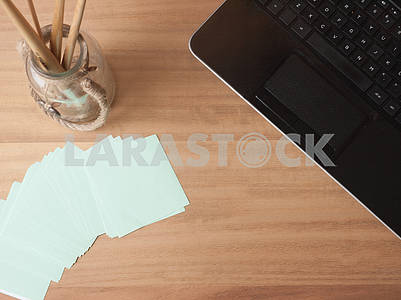 Tabletop Laptop and Note Paper