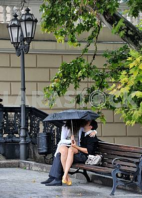 Young couple kissing on a bench