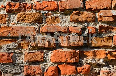 A fragment of an old brick wall