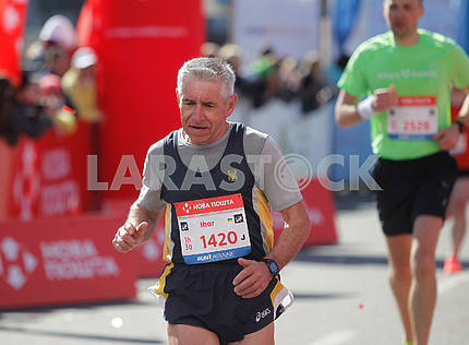 An elderly runner at a distance