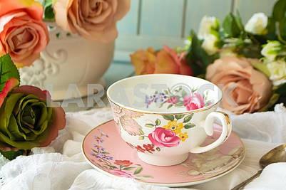 Vintage teacup, frame of pastel roses flowers
