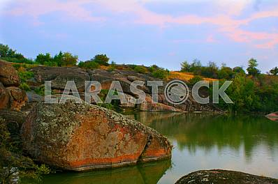 """The tract """"Cascades, a massive granite blocks of the Lower Proterozoic migmatites - members of the Ukrainian Shield, an ancient tectonic structure of Ukraine."""