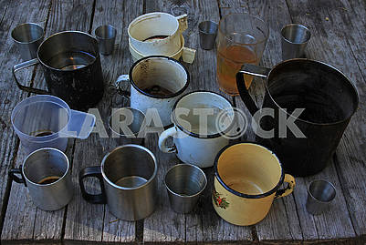 Metal and plastic mugs and glasses