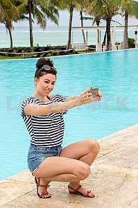 Selfies by the pool overlooking the ocean