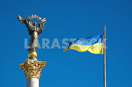 National flag of Ukraine and monument of independence