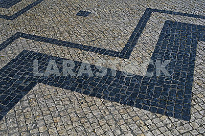 Traditional portuguese stone mosaic calcade in Lisbon