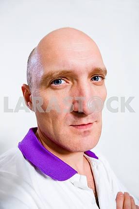 Portrait of the man. Blue eyes. Bald