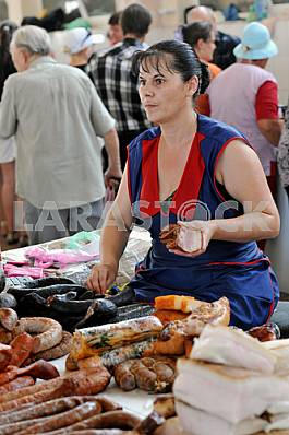 A woman sells meat on the market July 5, 2012