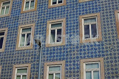 The old facade of the building is covered with azulejo ceramic tile