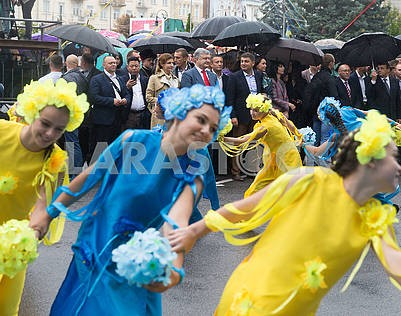 Girls in yellow and blue suits