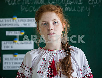 Red-haired girl in embroidery