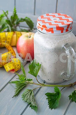 Smoothie with apples, bananas, nettle. Organic diet, healthy lifestyle concept. Tape mesure