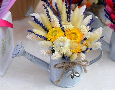 Decorative watering can with yellow flowers