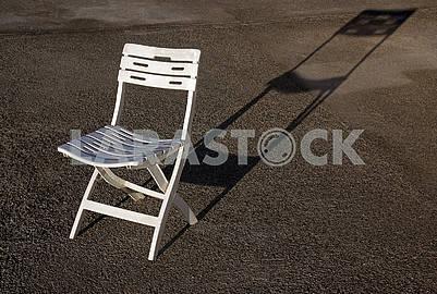 Empty white modern plastic chair