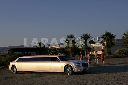 Girls near the limousine Chrysler 300 on the streets of Cyprus