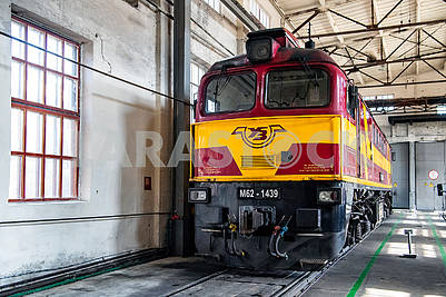 Diesel locomotive in depot