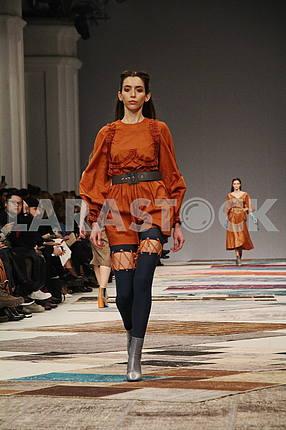 Girl in brown dress
