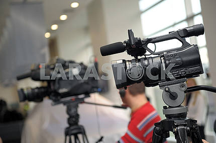 Videocamera and journalists