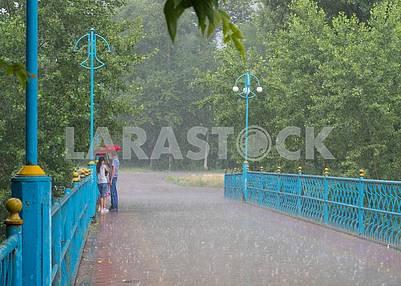 People on the bridge in the rain