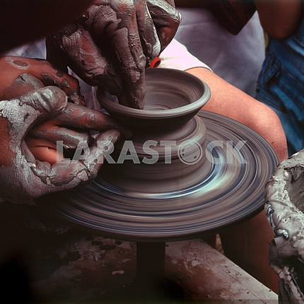 Potter working on potter's wheel