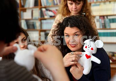 Women learn to make handmade soft toys and souvenirs