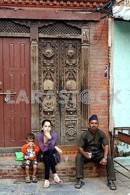 Nepalese family have carved door