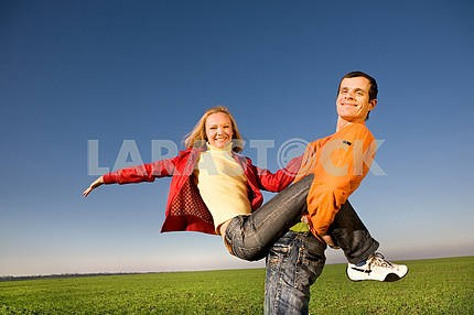 Young couple playing around in nature