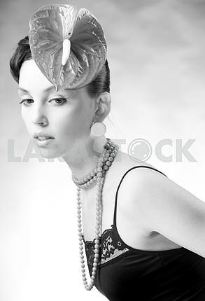 Trend model with a flower on the head. Ideal skin. With a brilli