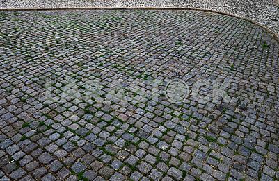 Simple rough gray concrete street cobblestone pavement