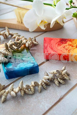 Natural colorful handmade soap on wooden table, spa set