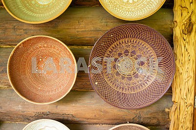 Rustic handmade ceramic and clay bowls and plates decorated by traditional ornament and pattern