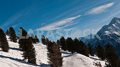 Paratrooper in the sky against a background of mountains