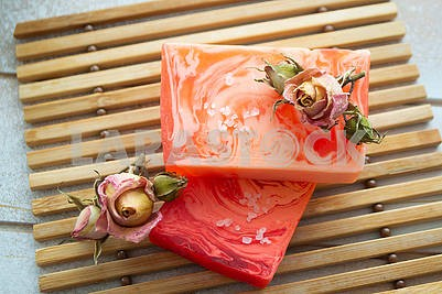 Handmade rose natural soap close up, with dry vintage roses
