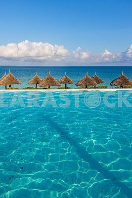 Thatched beach umbrellas