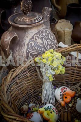 Ukrainian clay teapot with basket