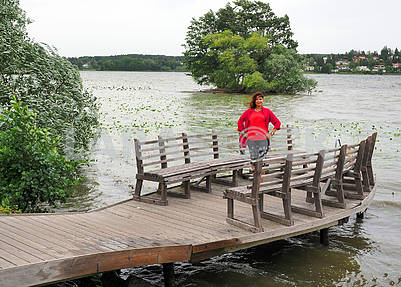 Woman in red on the pier