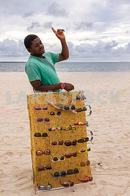 selling sunglasses on the beach.27.04.2016